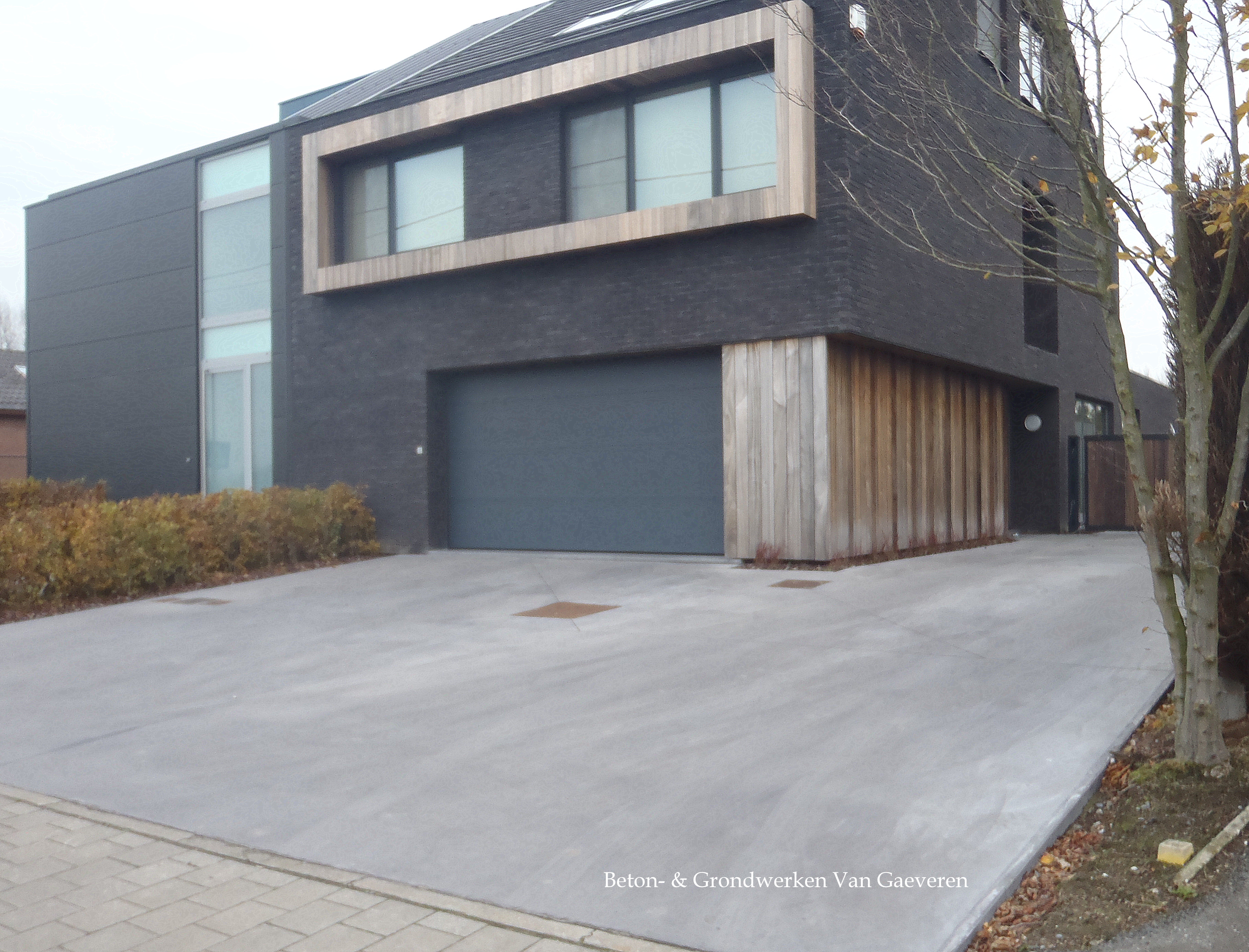 Oprit in beton beton grondwerken van gaeveren nv for Lay outs buiten helling